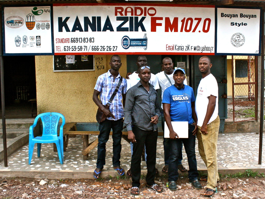 KaniaZik FM's team proudly posing in front of their radio station in Kindia, Guinea.